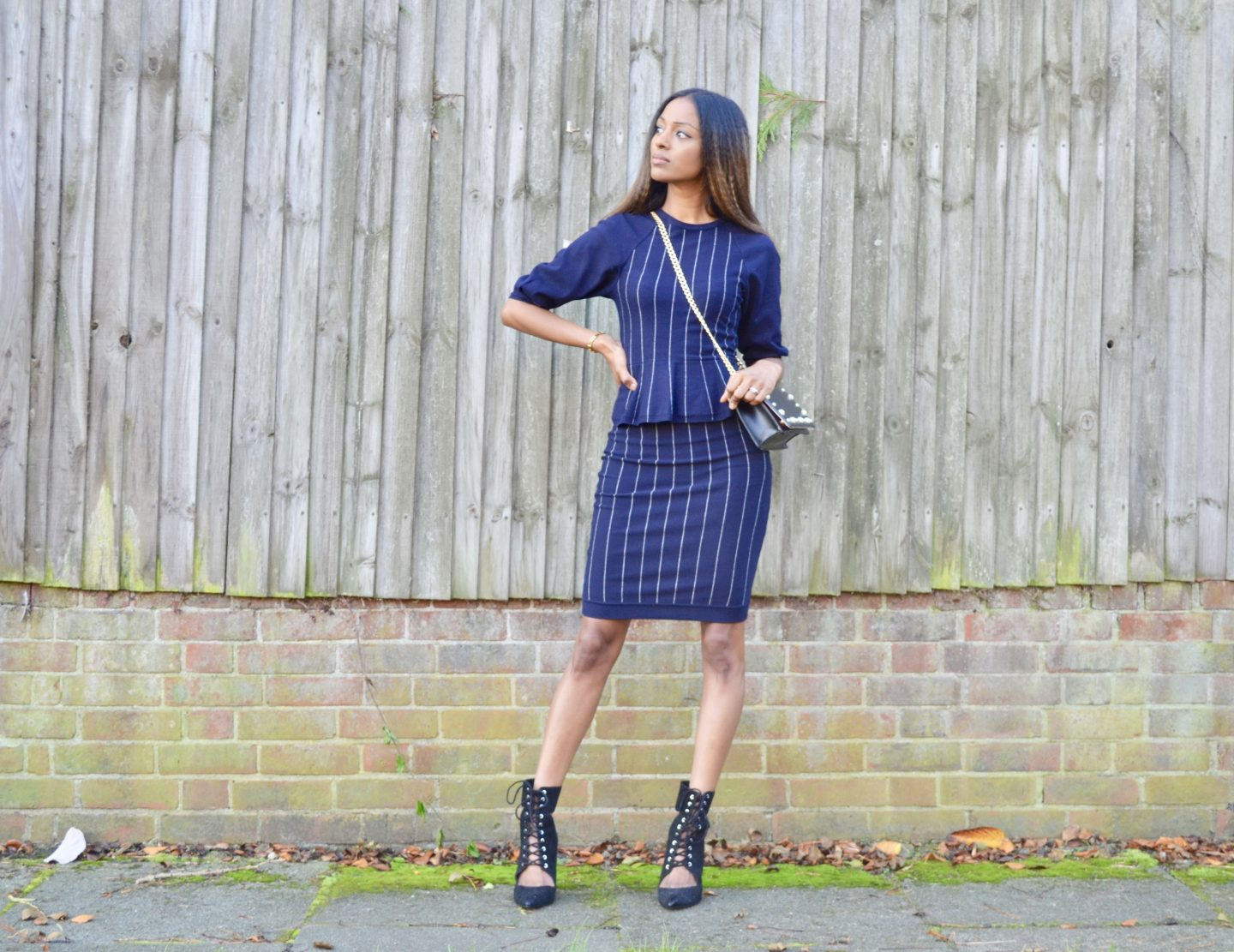 Striped peplum knit dress