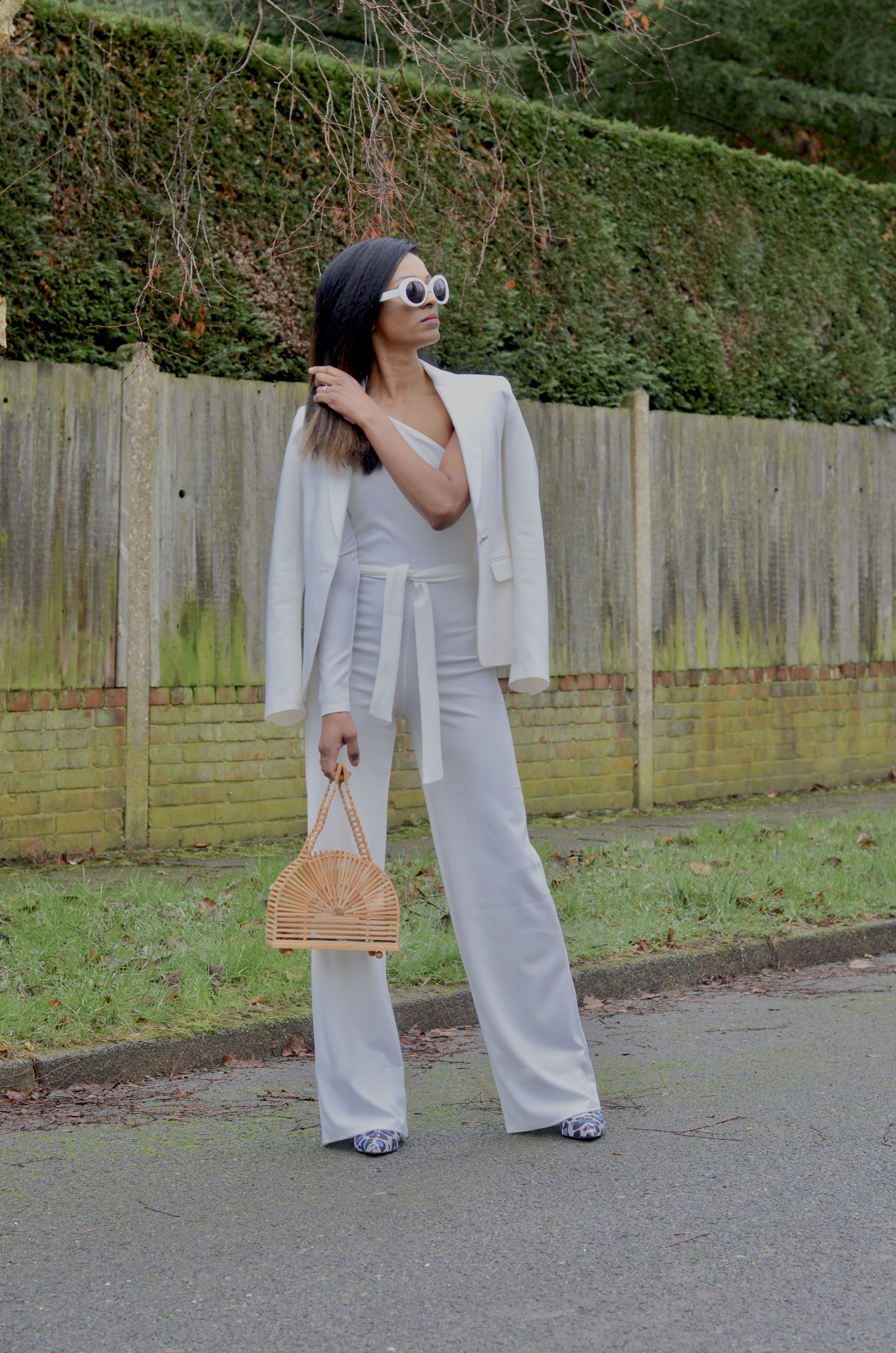 WHITE JUMPSUIT AND CULT GAIA DOME BAG